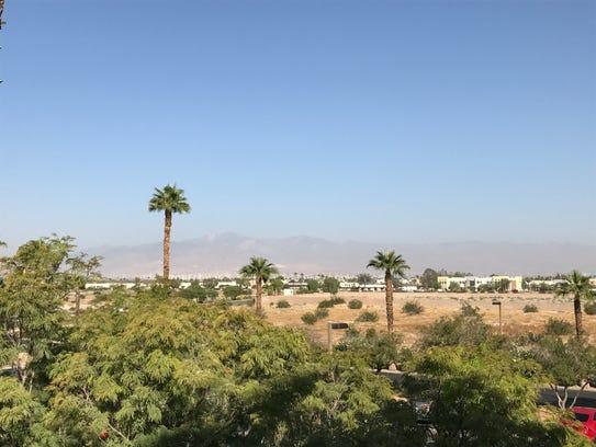 A debris fire in Desert Hot Springs cast a haze over