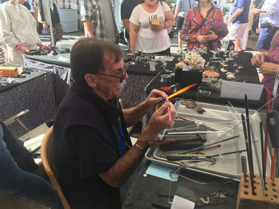 "Ken Curtiss, of ""Original Designs & Glass,"" blows glass Saturday at the 46th Annual Virginia Fall Foliage Art Festival."