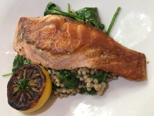 Djon's seared salmon with grape tomatoes, spinach,