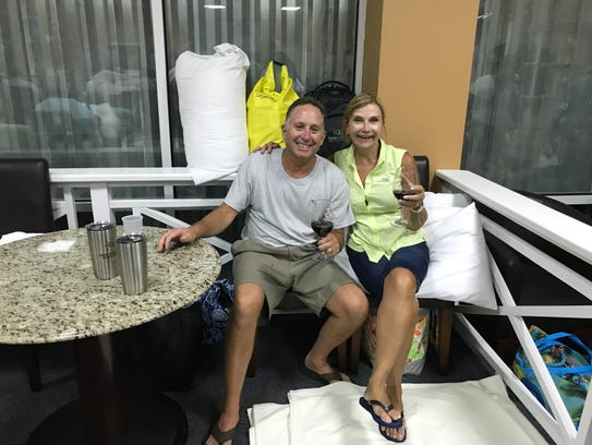 Rick and Brenda Fioretti sit in their part of the shelter