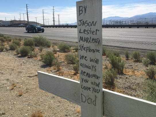 Family members' names are visible on a roadside memorial