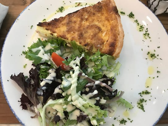Fluffy quiche lorraine with a side salad at La Colmar