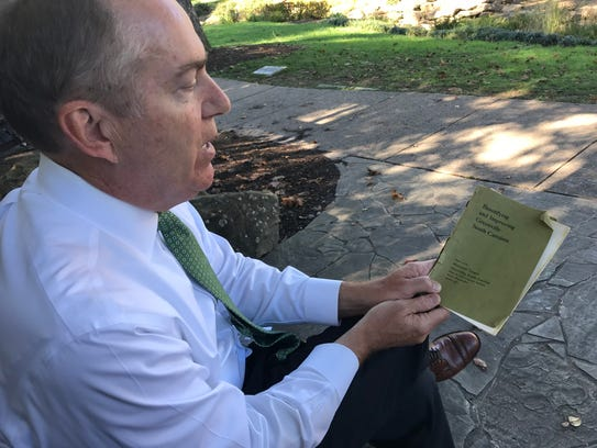 Greenville Mayor Knox White holds a 1907 report recommending
