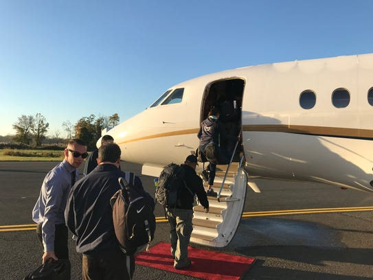 Members of a delegation from Robert Wood Johnson Barnabas Health and CareOne board a jet at Morristown Municipal Airport bound for Puerto Rico to deliver medical supplies and assess other essential needs as relief efforts continue there in the aftermath of hurricane Maria. Oct. 27, 2017