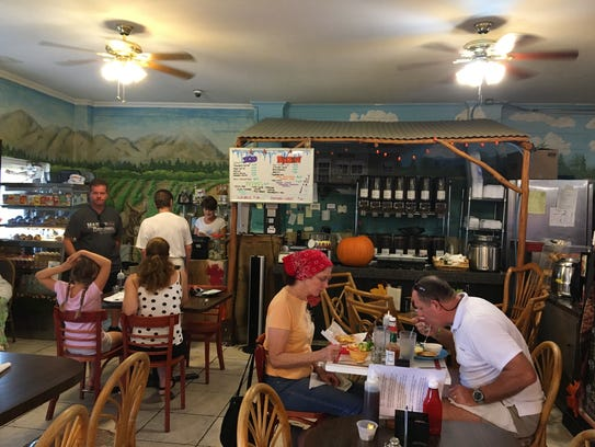 The dining rooms at Perfect Cup offer an island vibe