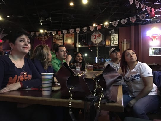 A group of Dodger fans eagerly watch Game 2 of the