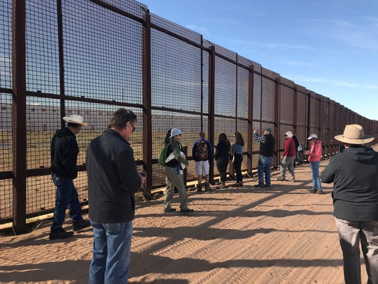"El Paso and Las Cruces community members, who attended the ""No Walls in the Wild"" event, inspect the border wall Saturday at the U.S.-Mexico border near Sunland Park."