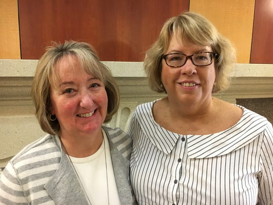 Susan Huppert, left, of Des Moines University and Peggy