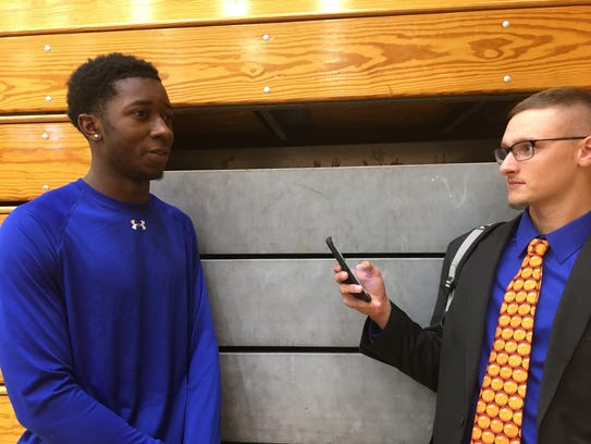 Seton Hall guard Myles Cale (left) speaks with a reporter