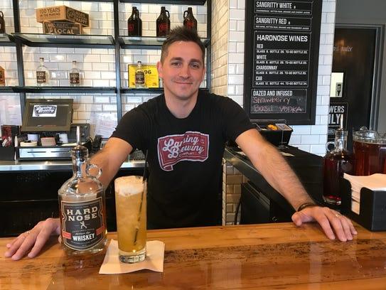 Lansing Brewing Company bartender Daniel Tucker with