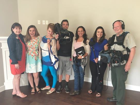 "Kelly Williams Brown poses with her roommate Brooke Jackson-Glidden, her real estate agent Rhonda Laughlin and the ""House Hunters"" production team July 7. The episode will air on HGTV at 10 p.m. Nov. 9."