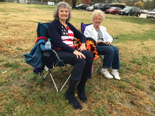 Betty Sims and Juanita Reeves wait for the parade to
