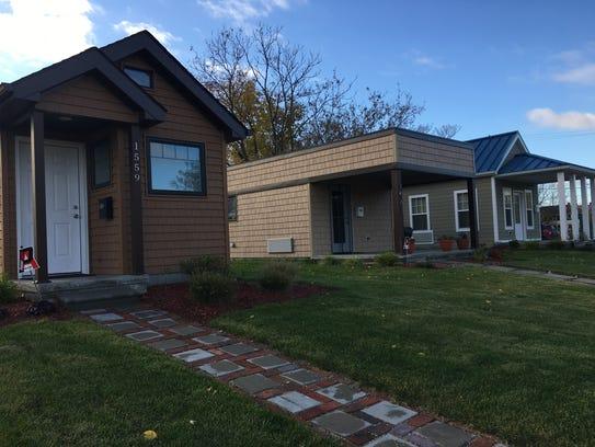 Three of the already constructed tiny homes on Elmhurst