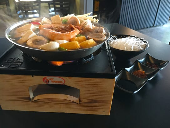 A Ragin' Special hot pot served with a kim chi soup