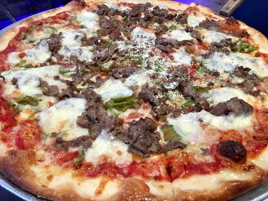 The cheesesteak pizza ($20.99 for a large) comes topped