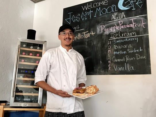 Owner and chef Nico Rodriguez holds the fried chicken sandwich, with mayonnaise, prickly pear, pickles and spicy slaw. Rodriguez opened Desert Moon Cafe in Downtown El Paso about 18 months ago.