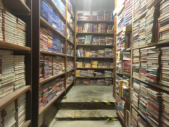 The shelves of the Book Nook are lined from top to