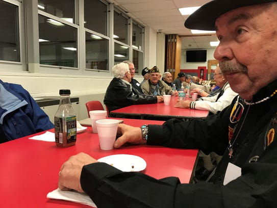 William Isenberg, a Vietnam veteran, enjoys some conversation