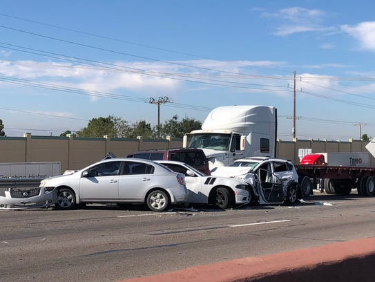 Police investigate a nine-vehicle crash on Interstate