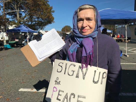 Helga Moor, 75, of Clifton, a volunteer with NJ Peace Action, displays the petition signatures she garnered during a signup in Montclair on Saturday, Nov. 11, 2017.