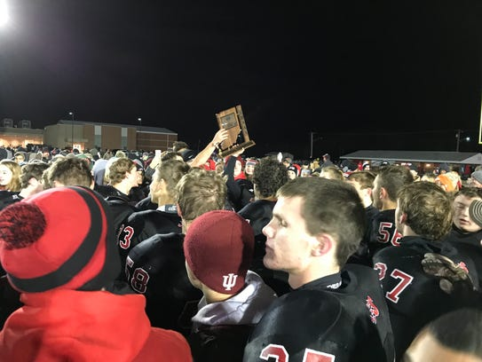 Southridge players hold the Class 2A regional trophy