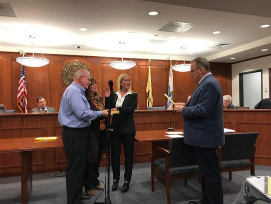 Mayor Michael McPartland, right, swears in Christina