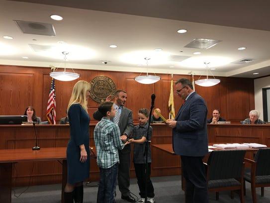 Edgewater Mayor Michael McPartland swears in Edmond