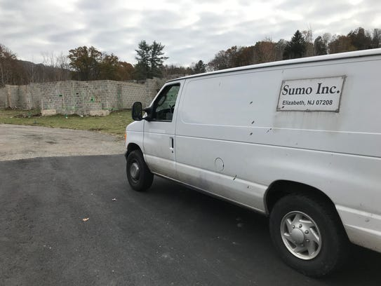 A van is parked at the Lakeside Manor townhouse construction