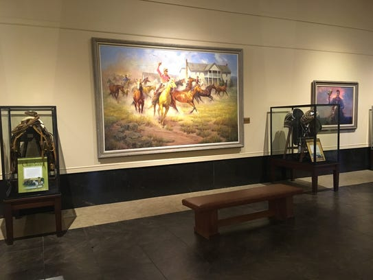 There are many paintings and photos of Will Rogers