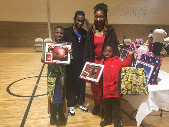 Brothers Terryon, 9, and Jeremiah, 7, show off their