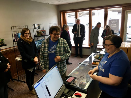 Amanda Wermers, right, and her husband Ben, center, recently opened a downtown pop-up location of their store Game Chest.