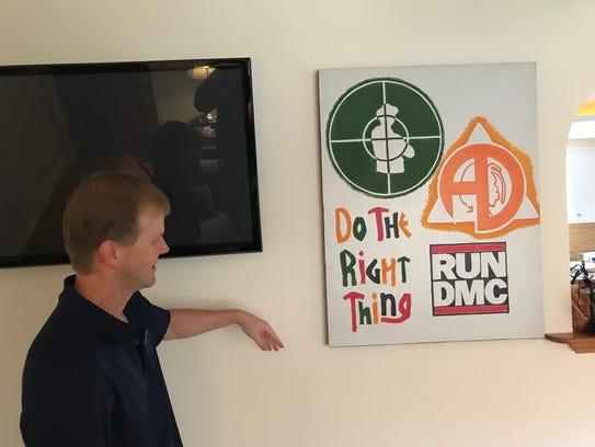 Todd Schweisinger shows off some hip-hop art inside