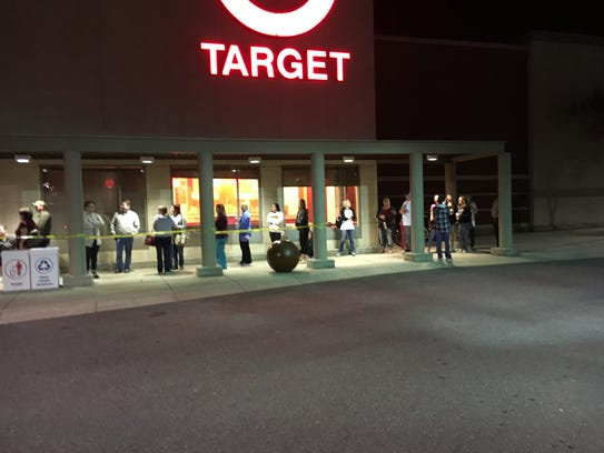 Black Friday customers wait for Target to open Thursday.