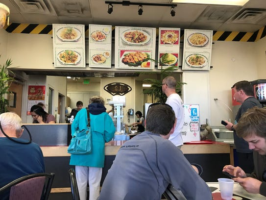 People line up to place orders at Sally's Kitchen in