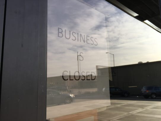 The closed-for-business sign on the front door of Z'Mariks