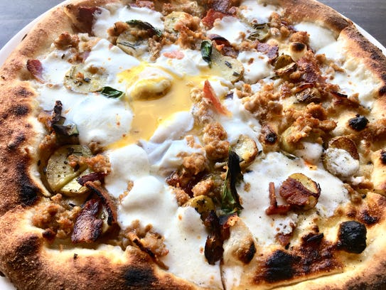 The egg n' bacon pizza ($11) is topped with mozzarella,
