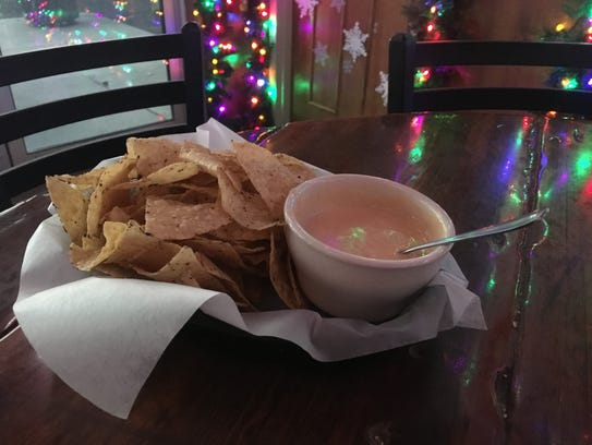 An order of chili con queso from Coach's Pizza in West