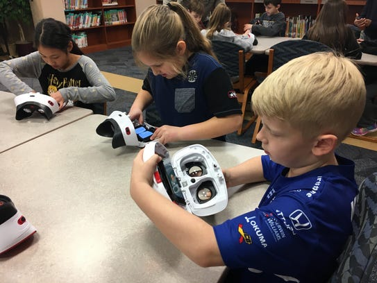 Third grade students at Noble Crossing Elementary lock