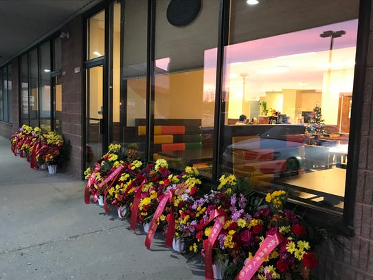 Flower bouquets lined the front of Sze Chuan Restaurant