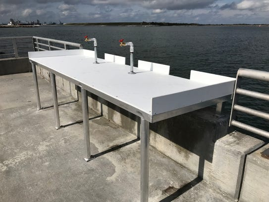The Malcolm McLouth fishing pier reopened Friday after extensive repairs following Hurricane Irma. A fish cleaning station is shown here.