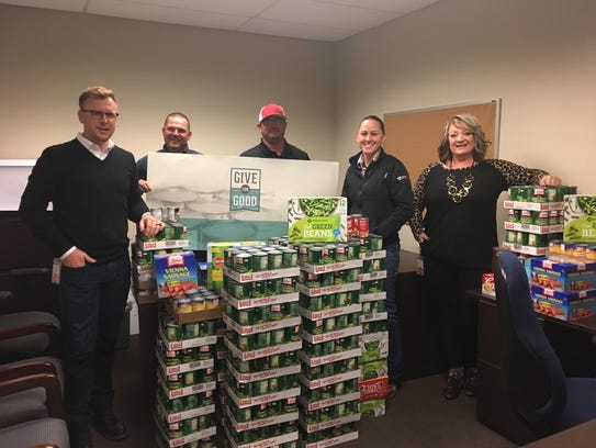 Devon employees with the donations.