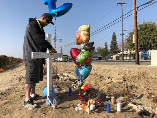 Chris Sanders takes down his nephew's memorial after