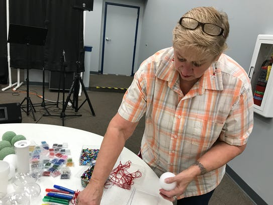 Connie Nehring gets ornament-making materials supplies