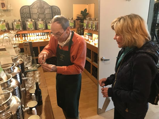 Roy Eckrote, Co-owner of The Olive Orchard, mixes up