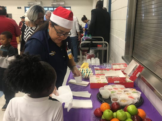 """Walmart """"elves"""" handed out gifts and baked goods to"""