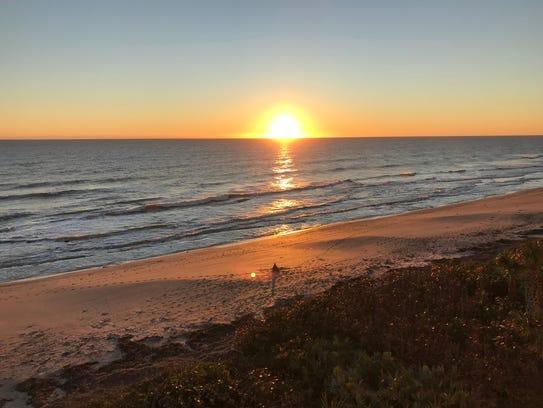 The sun rises over Indian Harbour Beach on a perfect