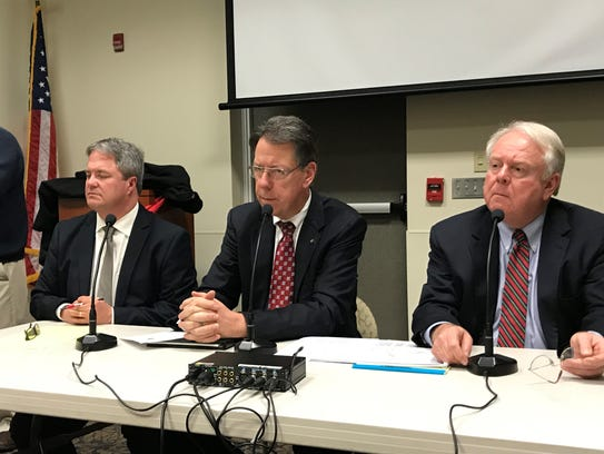 From left, town supervisors Michael Barker of Perinton,