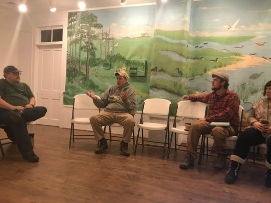 Mark Belknap, of Black Sheep Farm, speaks with a dozen