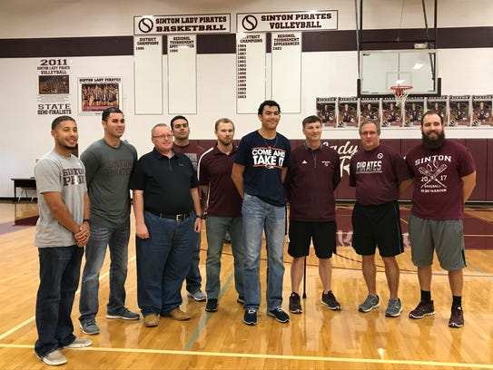 Andrew McGowan poses with Sinton coaching staff after