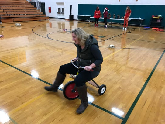 Teacher Kate Gabrielli struggles to get her tricycle